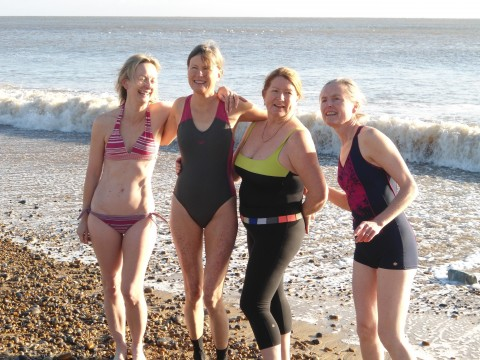 Four swimmers posed for photo out of the water. They are glowing with health. I am not sure of all the names but all are laughing and they certainly include Bryony Bax and Fiona Moore -- I think one of the other two is Lisa Kelly.