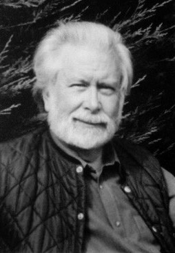 Photo of the author, with a genial half smile and a white beard, no glasses. He looks relaxed. Wearing a loose jumper and casual gilet, like a country squire on holiday.